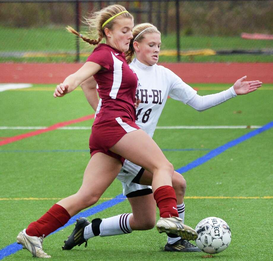 Scotia-Glenville's #8 Kim Denny, left, and Burnt Hills' #18 Morgan Burchhardt  during the sectional girls' soccer final at Stillwater High School Saturday Nov. 3, 2012.  (John Carl D'Annibale / Times Union) Photo: John Carl D'Annibale / 00019938A
