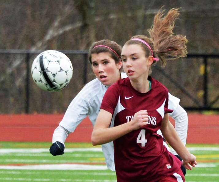 Burnt Hills' #11 Skye Kaler, left, and Scotia-Glenville's #4 Max Culhane during the sectional girls'