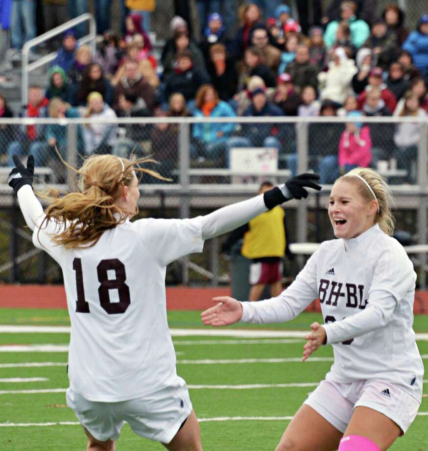 Burnt Hills' #18 Morgan Burchhardt and #23 Jillian Beatty celebrate a goal against Glenville during the sectional girls' soccer final at Stillwater High School Saturday Nov. 3, 2012.  (John Carl D'Annibale / Times Union) Photo: John Carl D'Annibale / 00019938A