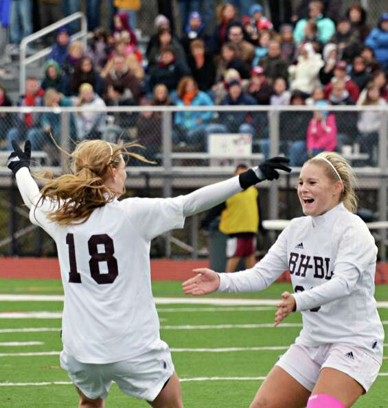 Burnt Hills' #18 Morgan Burchhardt and #23 Jillian Beatty celebrate a goal against Glenville during