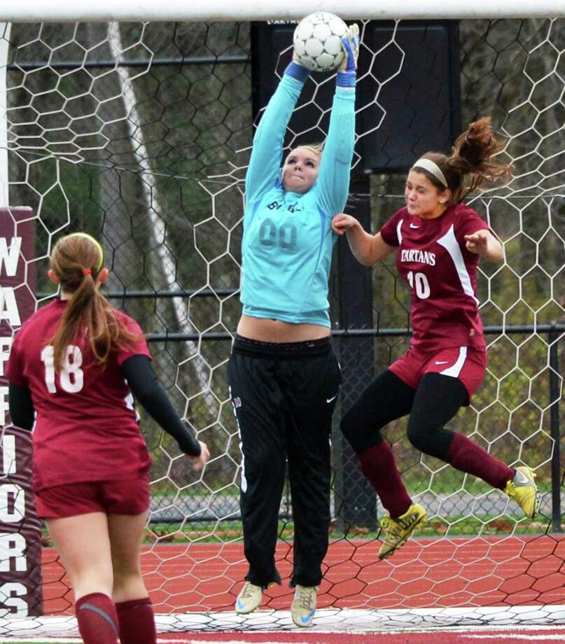 Burnt Hills' goalie Florie Comley makes a save during the sectional girls' soccer final against  Scotia-Glenville at Stillwater High School Saturday Nov. 3, 2012.  (John Carl D'Annibale / Times Union) Photo: John Carl D'Annibale / 00019938A