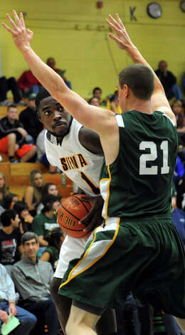Siena's O.D. Anosike(1), left, looks to pass as Skidmore's Kevin Dahill (21) defends during their exhibition basketball game on Saturday, Nov. 3, 2012, at Siena College in Loudenville, N.Y. (Cindy Schultz / Times Union) Photo: Cindy Schultz / 00019935A