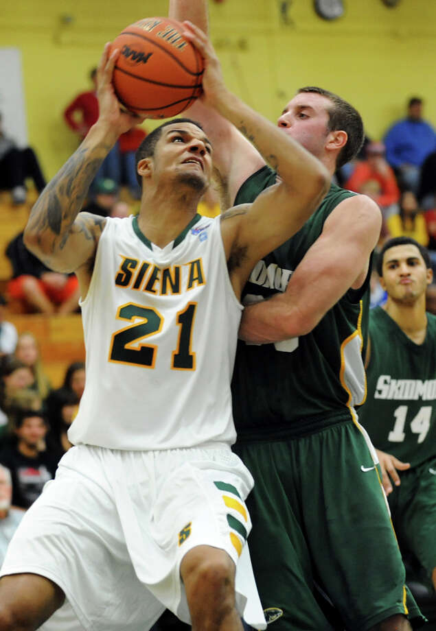 Siena's Davis Martens (21), left, looks to shoot as Skidmore's Connor Merrill (33) defends during their exhibition basketball game on Saturday, Nov. 3, 2012, at Siena College in Loudenville, N.Y. (Cindy Schultz / Times Union) Photo: Cindy Schultz / 00019935A