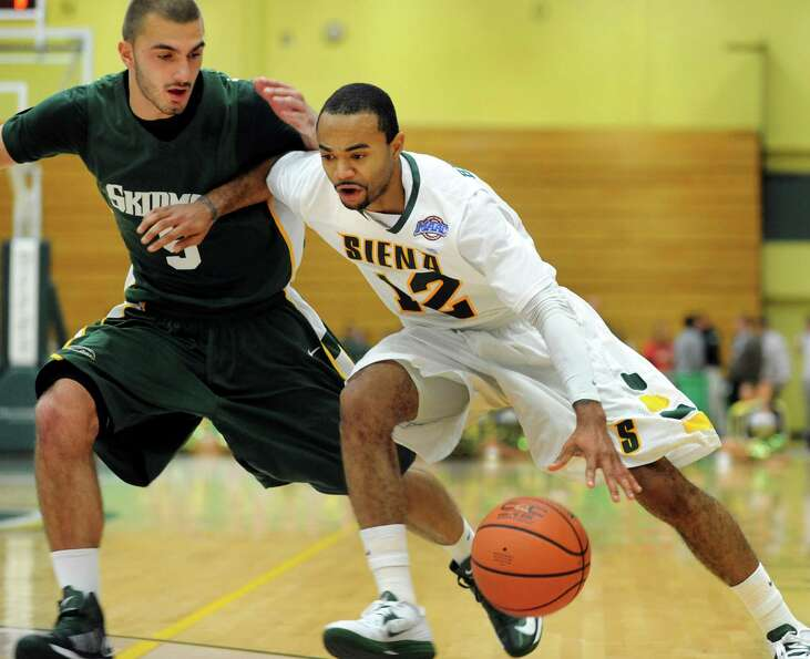Siena's Rakeem Brookins (12), right, drives up court as Skidmore's Aldin Medunjanin (5) defends duri