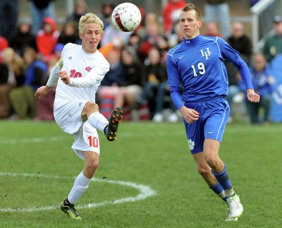 Maple Hill's Jake Johnson (10), left, connects with the ball as Hoosick Falls' Tyler Carr (19) defends during their Class C Championship soccer game on Saturday, Nov. 3, 2012, at Colonie High in Colonie, N.Y. (Cindy Schultz / Times Union) Photo: Cindy Schultz /  00019939A