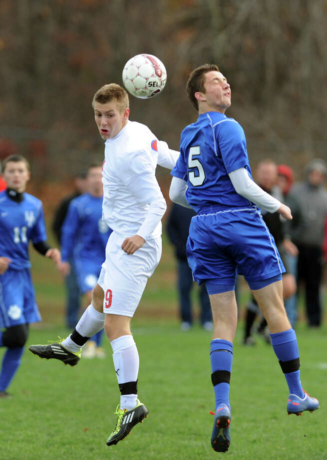 Maple Hill's Ryan Krupa (9), left, and Hoosick Falls' Taylor Baker (5) go up for a header during their Class C Championship soccer game on Saturday, Nov. 3, 2012, at Colonie High in Colonie, N.Y. (Cindy Schultz / Times Union) Photo: Cindy Schultz /  00019939A