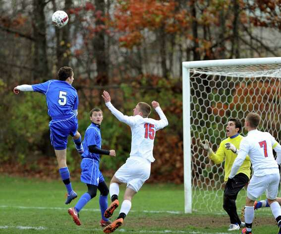 Hoosick Falls works to prevent a goad from a Maple Hill corner kick during their Class C Championship soccer game on Saturday, Nov. 3, 2012, at Colonie High in Colonie, N.Y. (Cindy Schultz / Times Union) Photo: Cindy Schultz /  00019939A