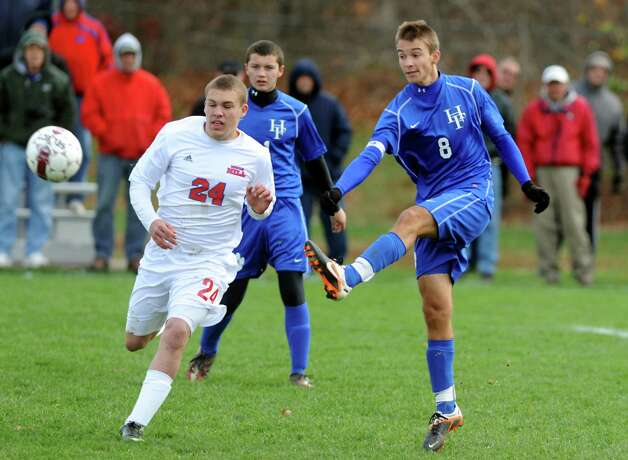 Hoosick Falls's Evan Phillips (8), right, connects with the ball as Maple Hill's Anthony Butler (24), left, defends during their Class C Championship soccer game on Saturday, Nov. 3, 2012, at Colonie High in Colonie, N.Y. (Cindy Schultz / Times Union) Photo: Cindy Schultz /  00019939A