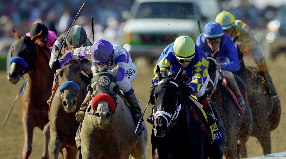 Shanghai Bobby, right, with Rosie Napravnik atop, edges out He's Had Enough, with Mario Gutierrez atop, at the wire to win the Breeders' Cup Juvenile horse race, Saturday, Nov. 3, 2012, at Santa Anita Park in Arcadia, Calif. (AP Photo/Mark J. Terrill) Photo: Mark J. Terrill