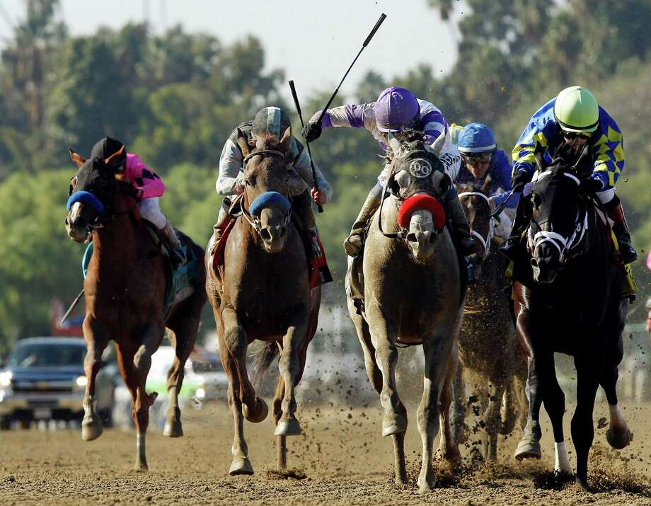 Shanghai Bobby, right, with Rosie Napravnik atop edges out He's Had Enough, with Mario Gutierrez atop, at the wire to win the Breeders' Cup Juvenile horse race, Saturday, Nov. 3, 2012, at Santa Anita Park in Arcadia, Calif. (AP Photo/Mark J. Terrill) Photo: Mark J. Terrill
