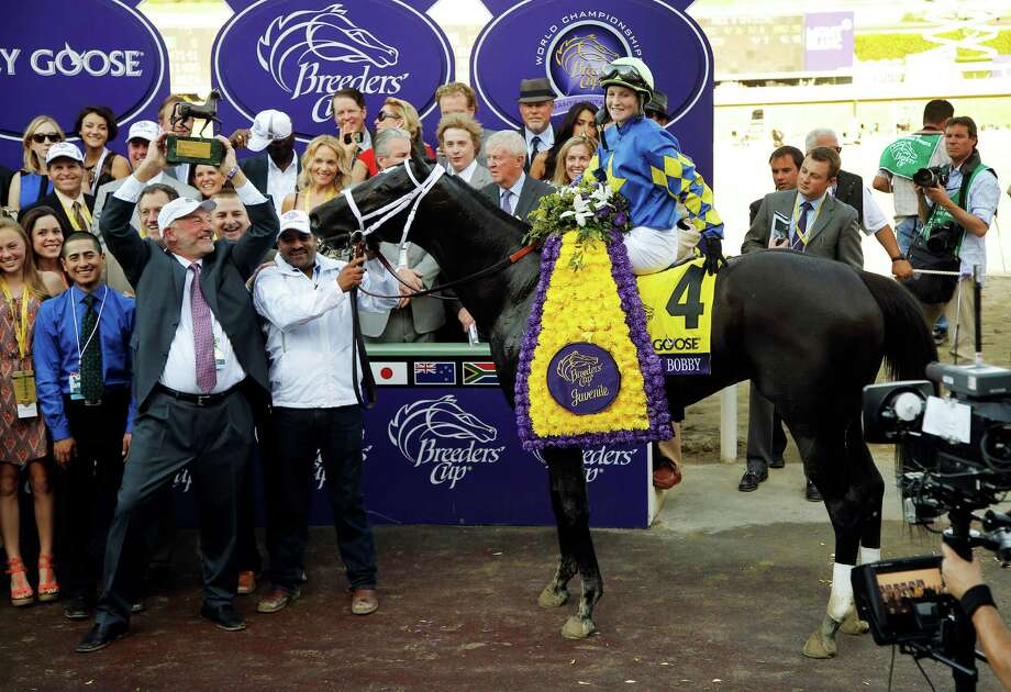 Jockey Rosie Napravnik poses with Shanghai Bobby in the Winner's Circle after their victory in the Breeders' Cup Juvenile horse race, Saturday, Nov. 3, 2012, at Santa Anita Park in Arcadia, Calif. (AP Photo/Jae C. Hong) Photo: Jae C. Hong