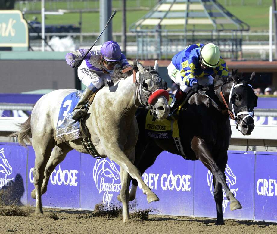Shanghai Bobby with jockey Rosie Napravnik beats out #3 He's Had Enough with jockey Mario Gutierrez to the wire to win The Breeders' Cup Juvenile at Santa Anita Park in Arcadia, California November 3, 2012. (Skip Dickstein/Times Union Photo: SKIP DICKSTEIN