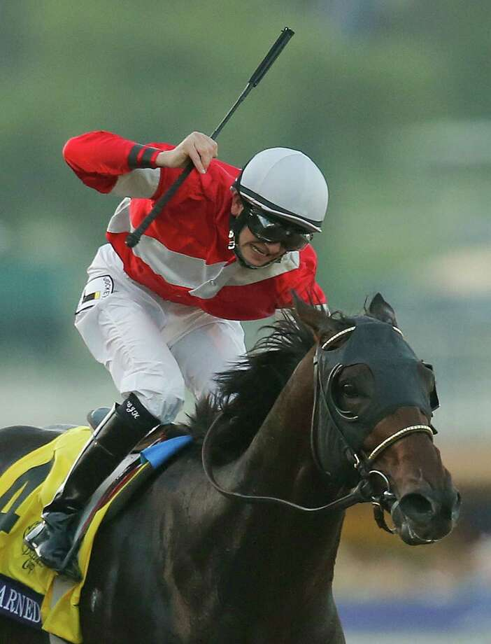 Brian Hernandez atop Fort Larned, reacts as he crosses the finish line ahead of Mucho Macho Man with Mike Smith atop to win the running of the Breeders' Cup Classic horse race, Saturday, Nov. 3, 2012, at Santa Anita Park in Arcadia, Calif.  (AP Photo/Jae C. Hong)  (AP Photo/Jae C. Hong) Photo: Jae C. Hong