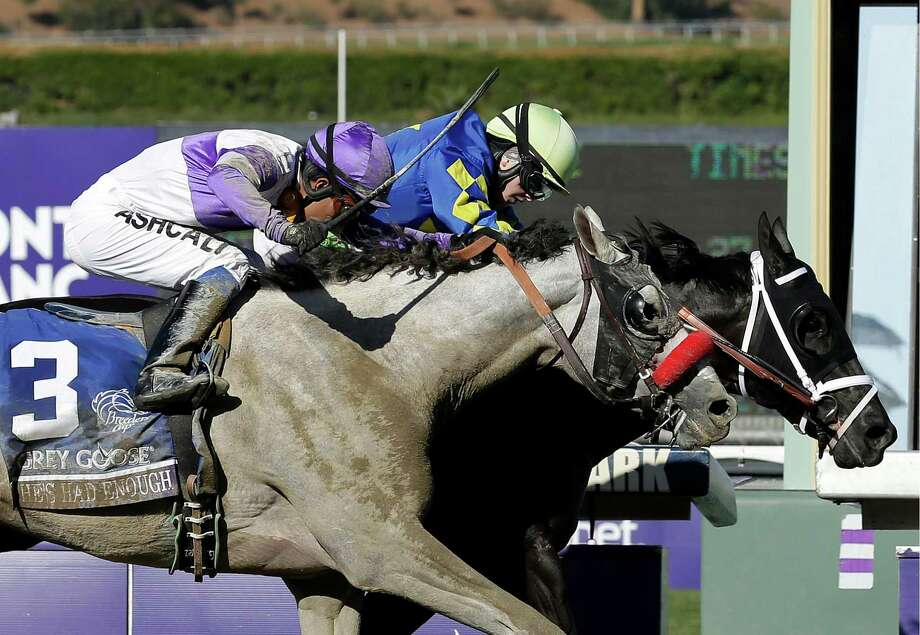 Shanghai Bobby, right, with Rosie Napravnik atop, crosses the finish line ahead of He's Had Enough, ridden by Mario Gutierrez, to win the the Breeders' Cup Juvenile horse race, Saturday, Nov. 3, 2012, at Santa Anita Park in Arcadia, Calif. (AP Photo/Gregory Bull) Photo: Gregory Bull