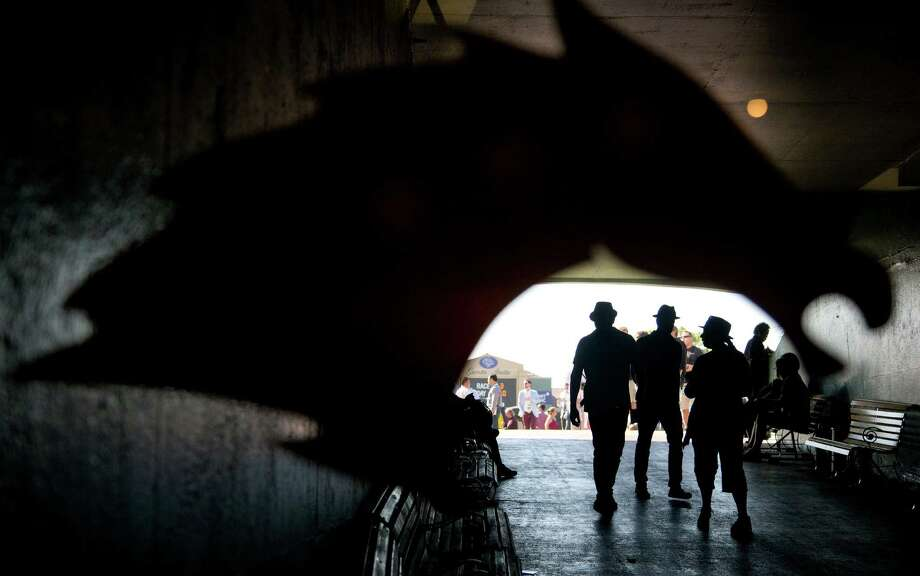 Spectators walk to the grandstand before the start of the third race on the second day of Breeders' Cup horse races, Saturday, Nov. 3, 2012, at Santa Anita Park in Arcadia, Calif. (AP Photo/Julie Jacobson) Photo: Julie Jacobson