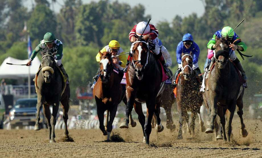 Tapizar, center, ridden by Corey Nakatani, crosses the finish line to win the Breeders' Cup Dirt Mile horse race, Saturday, Nov. 3, 2012, at Santa Anita Park in Arcadia, Calif.(AP Photo/Mark J. Terrill) Photo: Mark J. Terrill