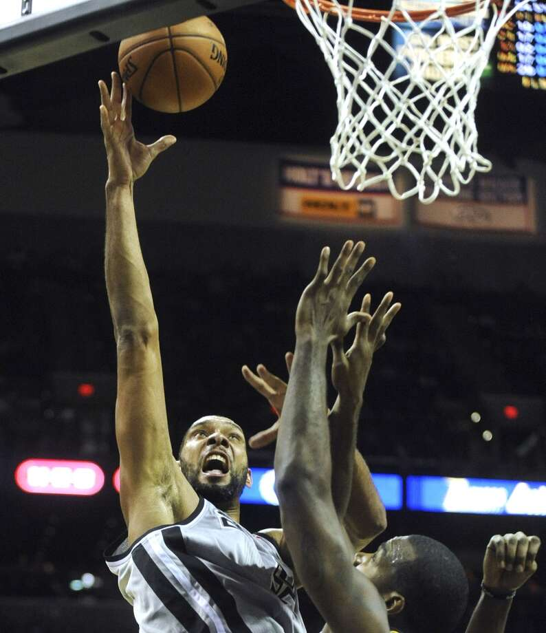 Spurs veteran forward center Tim Duncan scores after an assist from Danny Green during fourth-quarter NBA action at the AT&T Center on Saturday, Nov. 3, 2012. (San Antonio Express-News)
