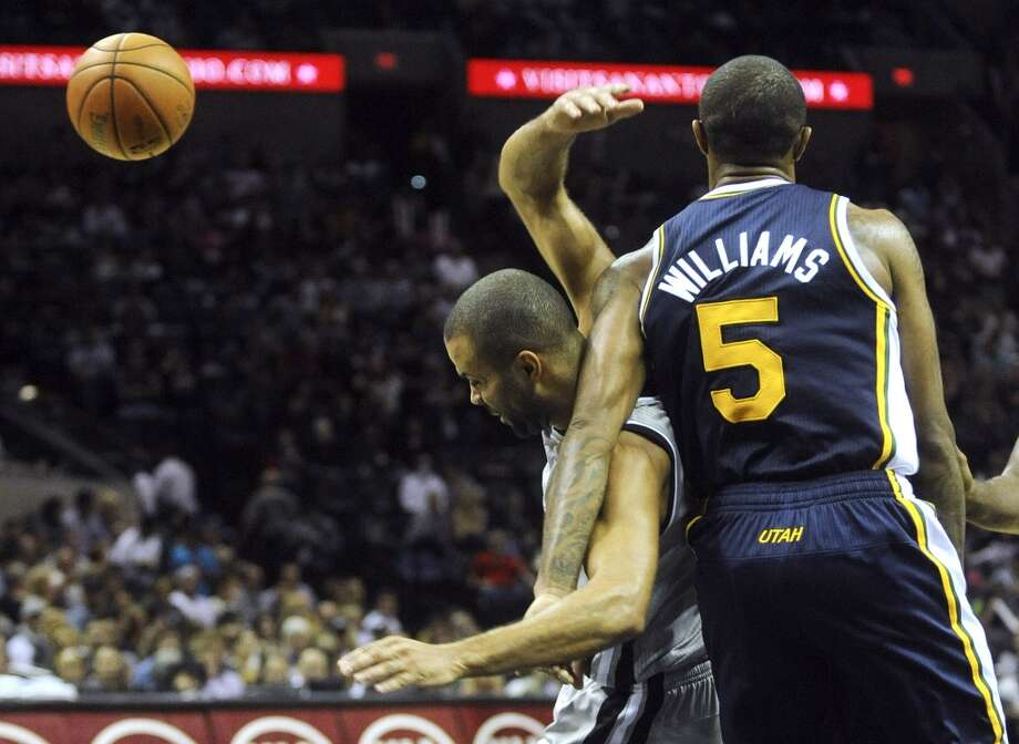 Mo Williams of the Utah Jazz flagrantly fouls San Antonio Spurs guard Tony Parker during NBA action at the AT&T Center on Saturday, Nov. 3, 2012. (San Antonio Express-News)