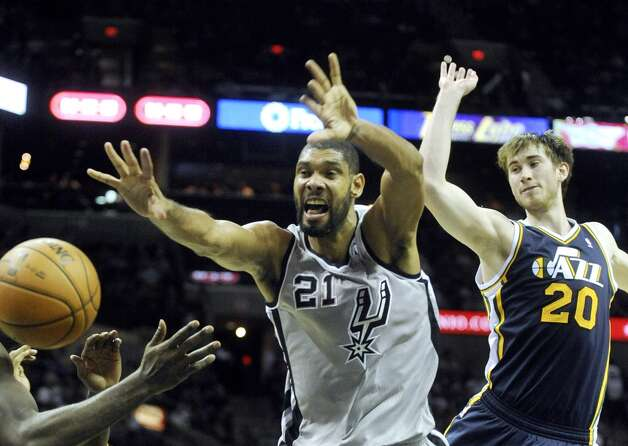 Tim Duncan of the San Antonio Spurs (21) loses the ball as Gordon Hayward of the Utah Jazz follows during NBA action at the AT&T Center on Saturday, Nov. 3, 2012. (San Antonio Express-News)
