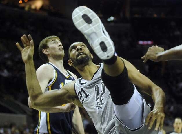 Tim Duncan of the San Antonio Spurs watches his shot during NBA action against the Utah Jazz at the AT&T Center on Saturday, Nov. 3, 2012. (San Antonio Express-News)