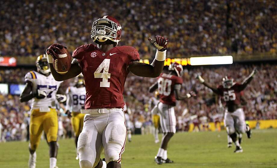 Alabama's T.J. Yeldon celebrates after scoring on a 28-yard pass play in the final minute to lift the Crimson Tide over LSU. Photo: Gerald Herbert, Associated Press