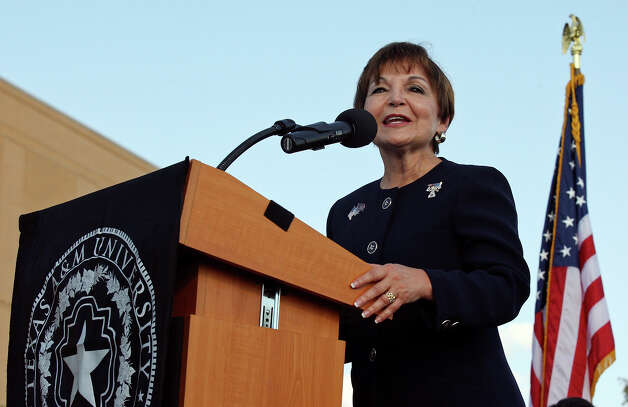 "Texas A&M Universtiy-San Antonio president Maria Hernandez Ferrier speaks Saturday Nov. 3, 2012 during the Texas A&M Universtiy-San Antonio ""Saluting America's Heroes"" event and ceremonial groundbreaking for two new buildings on the campus. The ""Saluting America's Heroes""  event was part of the Greater San Antonio Chamber of Commerce ""Celebrate America's Military"" events in honor of Veterans Day. The new buidings are the four-story Central Academic Building, which will have classrooms, labs and study space, and the stand-alone Patriots' Casa dedicated to serving the university's military community. Photo: Edward A. Ornelas, San Antonio Express-News / © 2012 San Antonio Express-News"