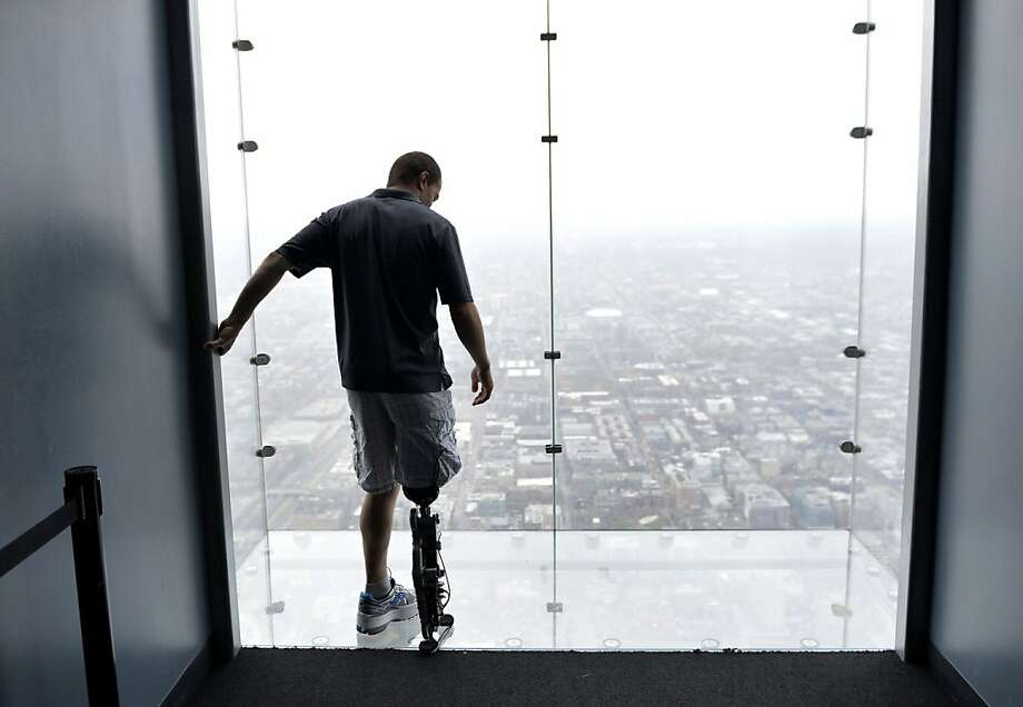 "Zac Vawter, fitted with an experimental ""bionic"" leg, looks out onto the Ledge at the Willis Tower, Thursday, Oct. 25, 2012 in Chicago. Vawter is training for the world's tallest stair-climbing event where he'll attempt to climb 103 flights to the top of the Willis Tower using the new prosthesis.  Vawter will put his bionic leg to the ultimate test Sunday, Nov. 4,  when he attempts to climb 103 flights of stairs to the top of Chicago's Willis Tower, one of the world's tallest skyscrapers. If all goes well, he'll make history with the bionic leg's public debut. Photo: Brian Kersey, Associated Press"
