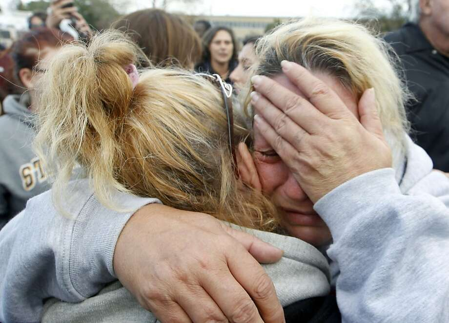 Bonnie Miller, right, cries with her sister-in-law Kelly Borden after New Jersey Gov. Chris Christie addressed a gathering Friday, Nov. 2, 2012, in Brick, N.J., after he toured some of the region devastated by Monday's storm surge from superstorm Sandy. Miller stayed in her home that was severely damaged during the storm. Photo: Mel Evans, Associated Press