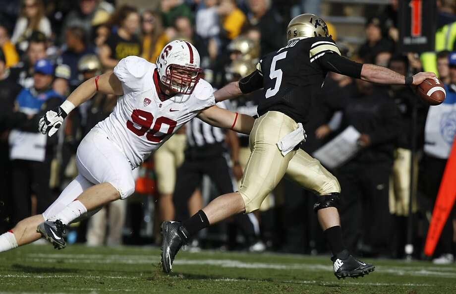 Stanford defensive end Josh Mauro, left, tries to tackle Colorado quarterback Connor Wood duringthe fourth quarter of Stanford's 48-0 victory in an NCAA college football game in Boulder, Colo., on Saturday, Nov. 3, 2012. (AP Photo/David Zalubowski) Photo: David Zalubowski, Associated Press