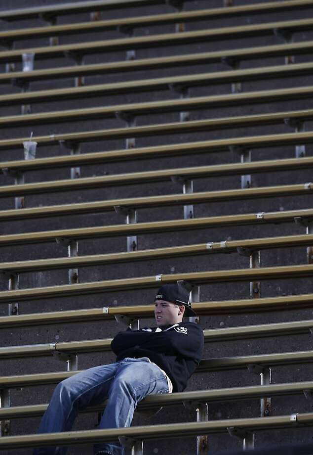 With time running out in the fourth quarter, a lone Colorado fan sits in the stands in the fourth quarter of Stanford's 48-0 victory over Colorado in an NCAA college football game in Boulder, Colo., on Saturday, Nov. 3, 2012. (AP Photo/David Zalubowski) Photo: David Zalubowski, Associated Press
