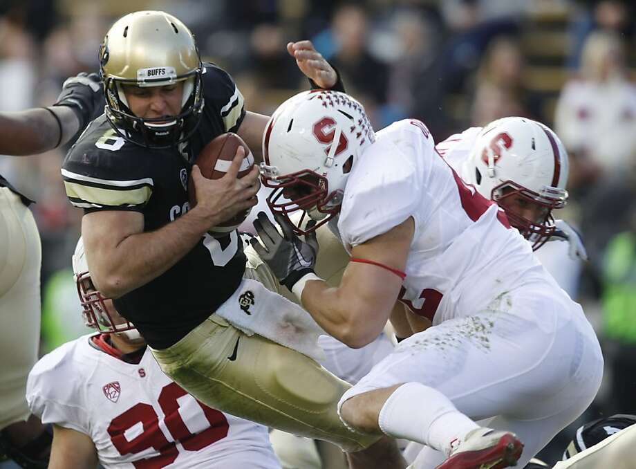 Alex Debniak sacks Colorado's Nick Hirschman. Stanford's run defense, No. 1 in the nation, has held the past three opponents to minus-36 yards. Photo: David Zalubowski, Associated Press
