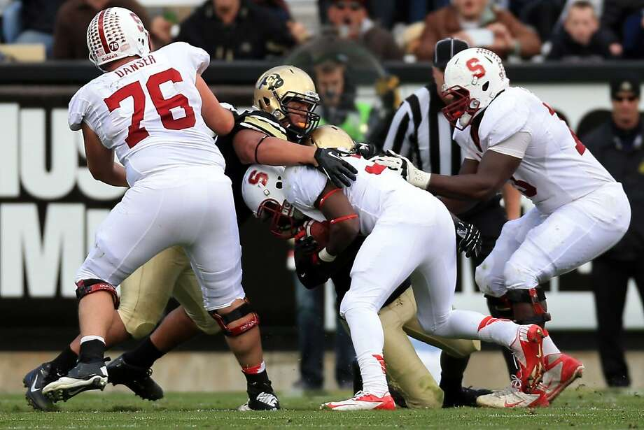 BOULDER, CO - NOVEMBER 03:  defensive lineman Justin Solis #57 of the Colorado Buffaloes tackles running back Anthony Wilkerson #32 of the Stanford Cardinals in the third quarter at Folsom Field on November 3, 2012 in Boulder, Colorado. Solis was injured on the play and had to be carried off the field as the Cardinal defeated the Buffaloes 48-0.  (Photo by Doug Pensinger/Getty Images) Photo: Doug Pensinger, Getty Images