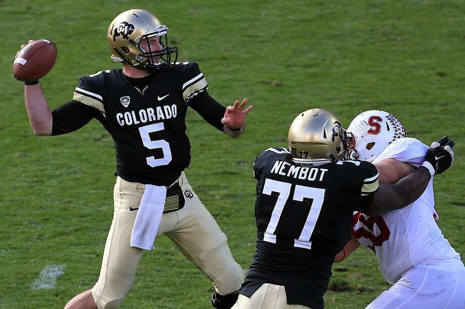 BOULDER, CO - NOVEMBER 03:  Quarterback Connor Wood #5 of the Colorado Buffaloes delivers a pass against the Stanford Cardinals at Folsom Field on November 3, 2012 in Boulder, Colorado. The Cardinal defeated the Buffaloes 48-0.  (Photo by Doug Pensinger/Getty Images) Photo: Doug Pensinger, Getty Images