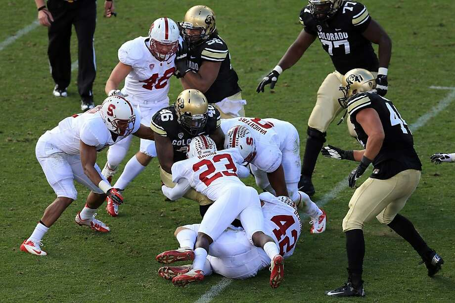 BOULDER, CO - NOVEMBER 03:  Fullback Christian Powell #46 of the Colorado Buffaloes is tackled by the Stanford Cardinals defense at Folsom Field on November 3, 2012 in Boulder, Colorado. The Cardinal defeated the Buffaloes 48-0.  (Photo by Doug Pensinger/Getty Images) Photo: Doug Pensinger, Getty Images