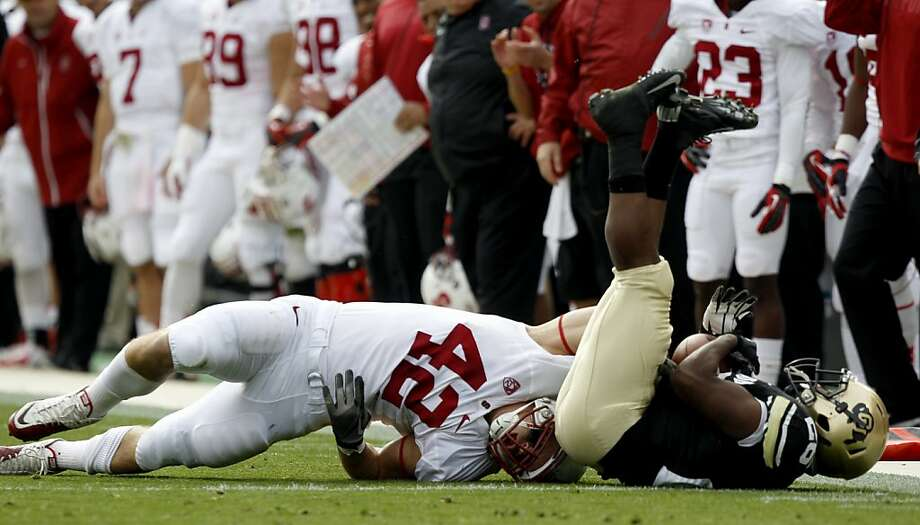 Stanford linebacker Alex Debniak (42) upends Colorado tailback Tony Jones after Jones caught a pass in the first quarter of an NCAA college football game in Boulder, Colo., Saturday, Nov. 3, 2012. (AP Photo/David Zalubowski) Photo: David Zalubowski, Associated Press