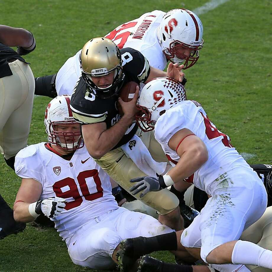 BOULDER, CO - NOVEMBER 03:  Quarterback Nick Hirschman #8 of the Colorado Buffaloes is sacked by defensive end Josh Mauro #90, linebacker Kevin Anderson #48 and linebacker Alex Debniak #42 of the Stanford Cardinals at Folsom Field on November 3, 2012 in Boulder, Colorado. The Cardinal defeated the Buffaloes 48-0.  (Photo by Doug Pensinger/Getty Images) Photo: Doug Pensinger, Getty Images