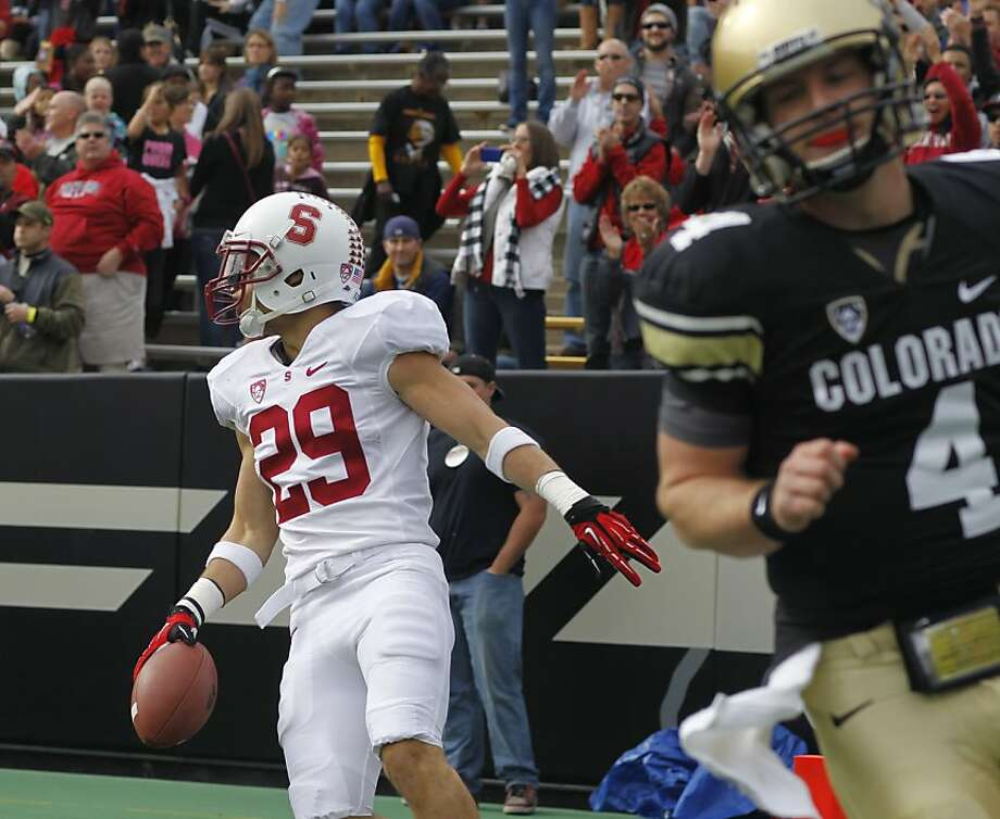 Stanford free safety Ed Reynolds, back, turns to celebrate his touchdown on an interception thrown by Colorado quarterback Jordan Webb, front, in the first quarter of an NCAA college football game in Boulder, Colo., on Saturday, Nov. 3, 2012. (AP Photo/David Zalubowski) Photo: David Zalubowski, Associated Press