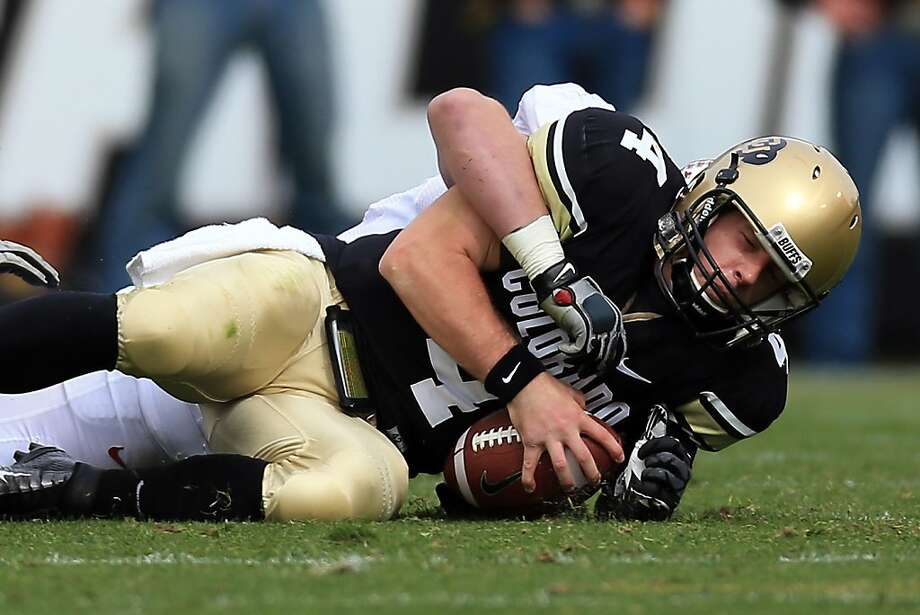 BOULDER, CO - NOVEMBER 03:  Quarterback Jordan Webb #4 of the Colorado Buffaloes is sacked by inebacker Chase Thomas #44 of the Stanford Cardinals at Folsom Field on November 3, 2012 in Boulder, Colorado.  (Photo by Doug Pensinger/Getty Images) Photo: Doug Pensinger, Getty Images