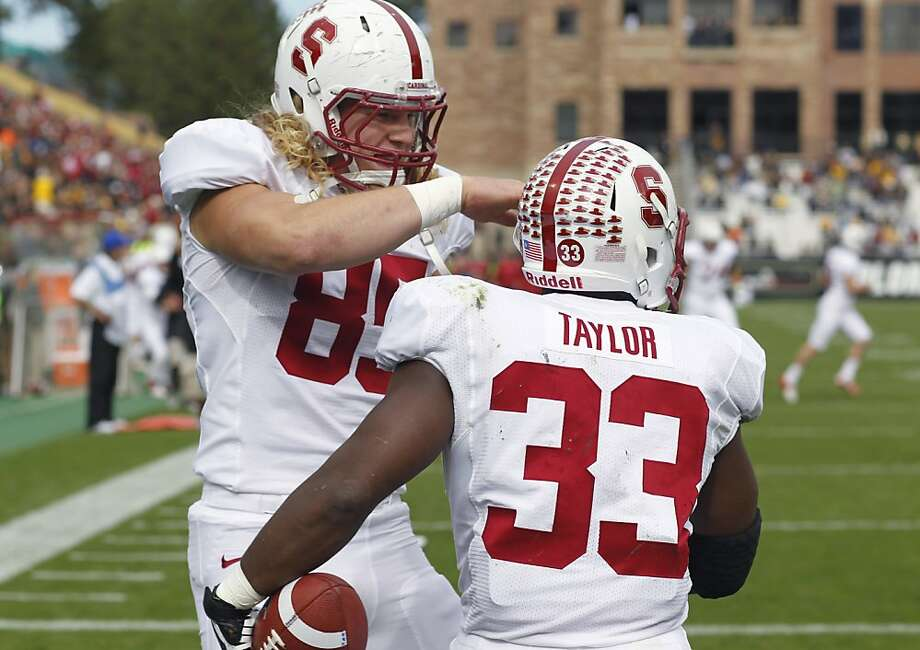 Stanford fullback Ryan Hewitt, left, congratulates running back Stepfan Taylor after his touchdown against Colorado in the second quarter of an NCAA college football game in Boulder, Colo., on Saturday, Nov. 3, 2012. (AP Photo/David Zalubowski) Photo: David Zalubowski, Associated Press
