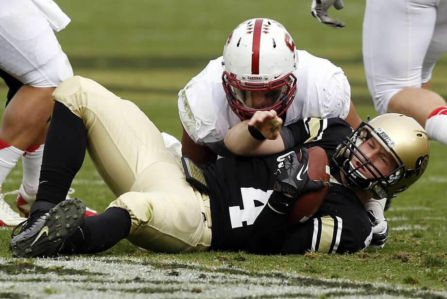Colorado quarterback Jordan Webb, front, is stopped after a short gain by Stanford linebacker A.J. Tarpley in the second quarter of an NCAA college football game in Boulder, Colo., Saturday, Nov. 3, 2012. (AP Photo/David Zalubowski) Photo: David Zalubowski, Associated Press