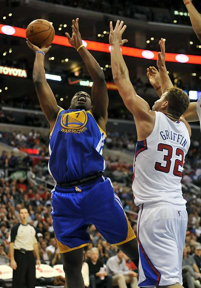 The Clippers' Blake Griffin tries to stop Carl Landry, who had 23 points with Andrew Bogut unavailable. Photo: Richard Hartog, Associated Press