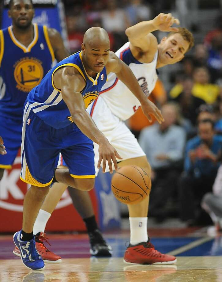 Los Angeles Clippers forward Blake Griffin, right, looks on as Golden State Warriors center guard Jarrett Jack, left, steals the ball in the first half of an NBA basketball game n Los Angeles on Saturday, Nov.  3, 2012. (AP Photo/Richard Hartog) , Photo: Richard Hartog, Associated Press