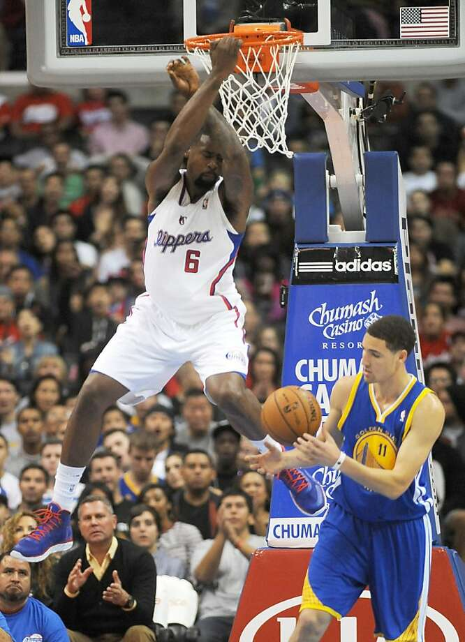 Los Angeles Clippers center DeAndre Jordan (6) finishes off a slam dunk as Golden State Warriors guard Klay Thompson, right, catches the ball in the first half of an NBA basketball game in Los Angeles on Saturday, Nov.  3, 2012. (AP Photo/Richard Hartog) , Photo: Richard Hartog, Associated Press