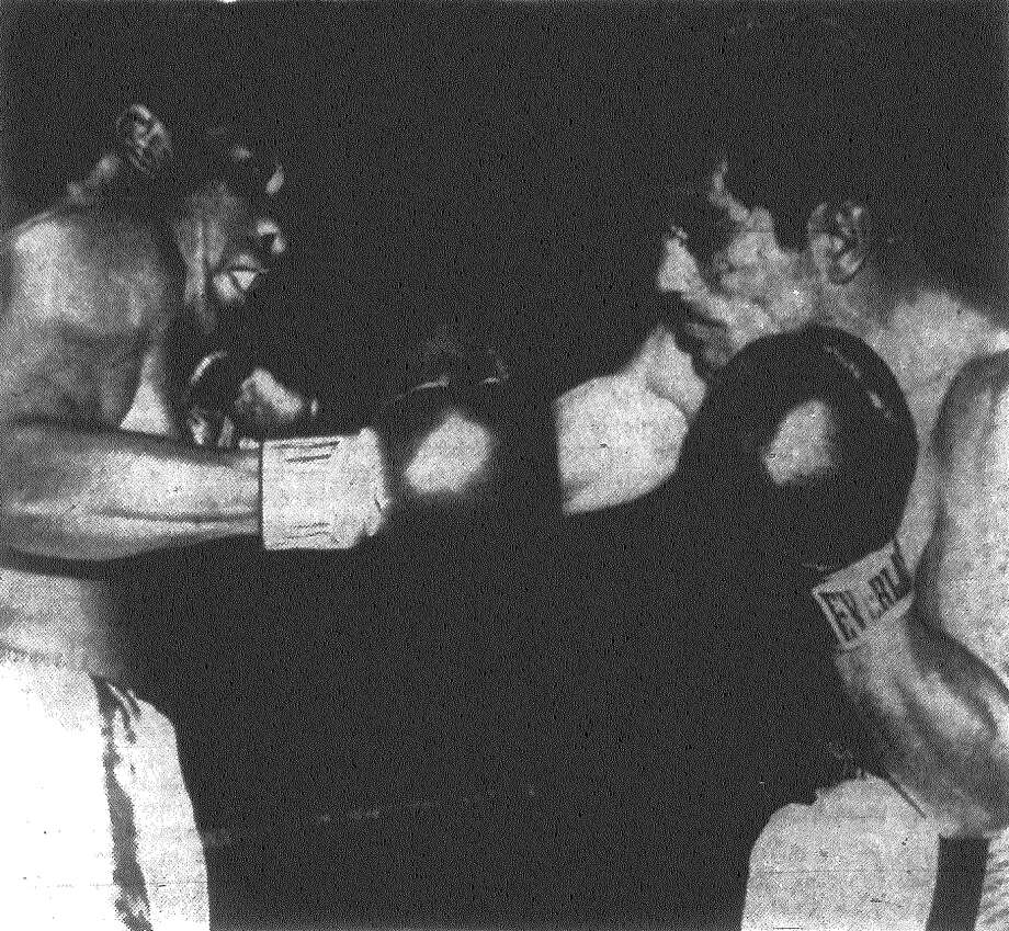 Santiago Gutierrez, right, sported a bad cut over his left eye from the first minute on here last night but fired back and tried to slug with Luis Rodriguez before doctors called it off after the second. Published in the San Antonio News Nov. 7, 1962. Photo: File Photo