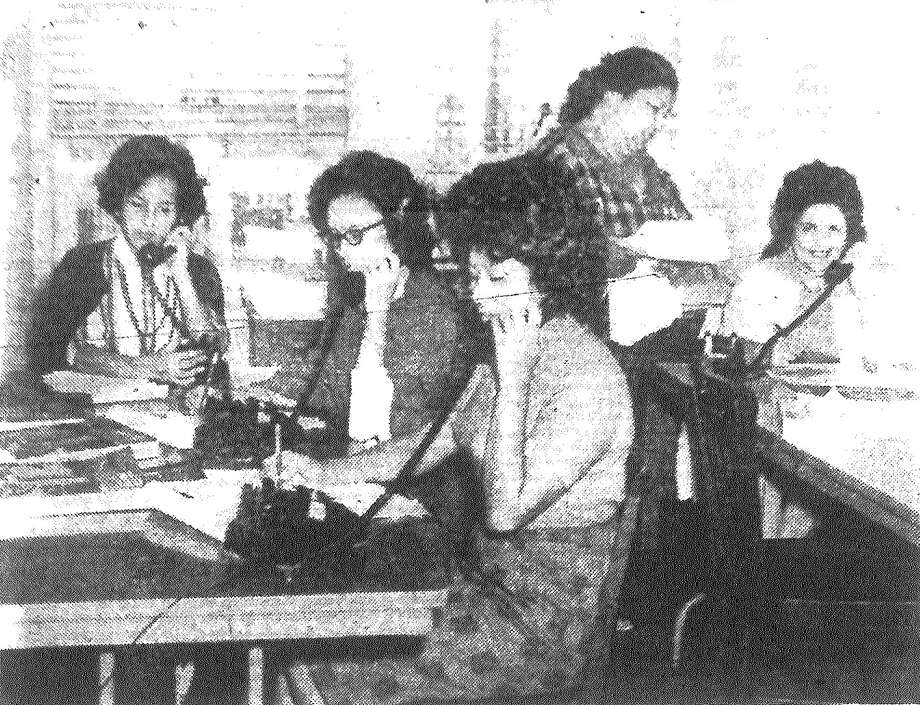 "Workers for both the Democratic and Republican parties manned the telephones Monday and will continue urging the voters to turn out Tuesday. Shown in the Democratic ""boiler room,"" the Tower Life Building, are workers urging the West Side to turn out strong. The workers are, left to right, Oralia de Leon, Mary Lou Dominguez, Virginia Longoria, Mrs. Queto Gallegos, supervisor, and Mrs. Trinidad B. Munez. Published in the San Antonio Express Nov. 6, 1962. Photo: File Photo"