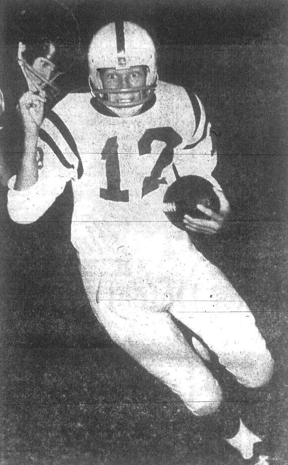 Larry Peel of the Highlands Owls was returning a punt 15 yards on this play in Friday night's game against the Harlandale Indians. Published in the San Antonio Express Nov. 3, 1962. Photo: File Photo