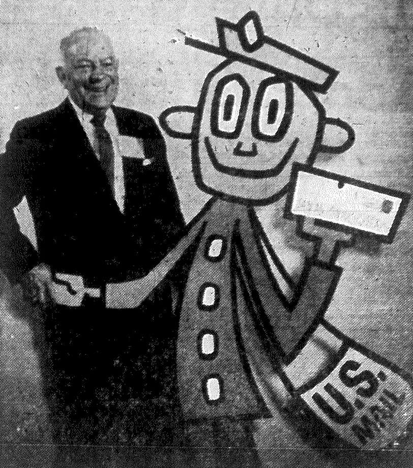 "Postmaster Dan Quill of San Antonio this week met the Post Office Department's new ""Mr. ZIP,"" the central figure in an accelerated campaign to speed America's mail through universal use of post office zone numbers. Published in the San Antonio Express Nov. 2, 1962. Photo: File Photo"