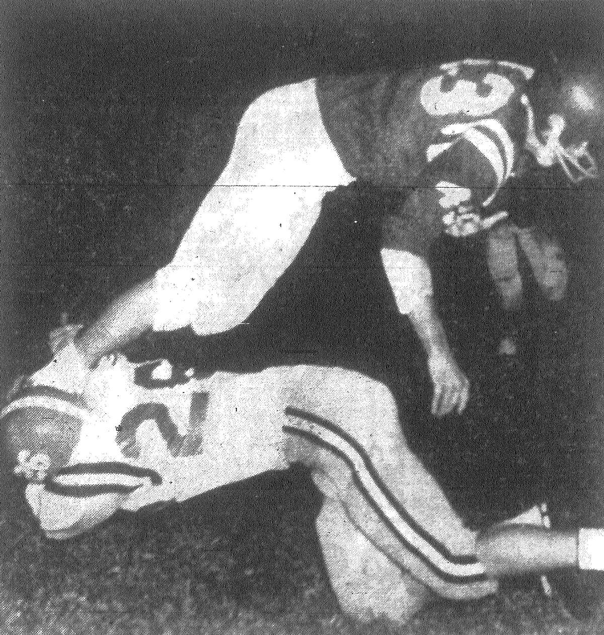 MacArthur's Mike Wilgren didn't grab much when he went for Jefferson's Bob Mouton, but when you can click a fellow's heels together he comes down anyway. Mouton had taken a pass from Patrick Shannon for 13 yards on this play in the second period as the Mustangs went for touchdown No. 2 during a 20-14 victory over MacArthur at Alamo Stadium. Published in the San Antonio Express Nov. 2, 1962.