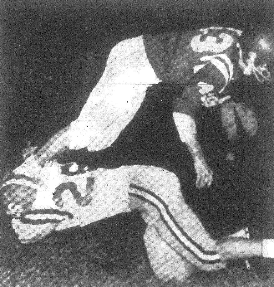MacArthur's Mike Wilgren didn't grab much when he went for Jefferson's Bob Mouton, but when you can click a fellow's heels together he comes down anyway. Mouton had taken a pass from Patrick Shannon for 13 yards on this play in the second period as the Mustangs went for touchdown No. 2 during a 20-14 victory over MacArthur at Alamo Stadium. Published in the San Antonio Express Nov. 2, 1962. Photo: File Photo