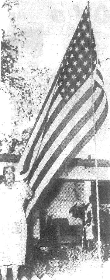 Mrs. Concepcion Medellin stands beside a flag she has raised each Armistice Day in memory of her son, Luciano Medellin, who was killed in the fighting in the Philippines during the closing months of World War II. Published in the San Antonio News Nov. 13, 1962. Photo: File Photo